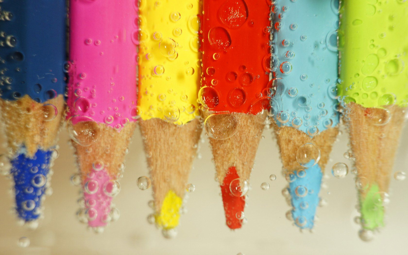 color pencils in water wallpaper background