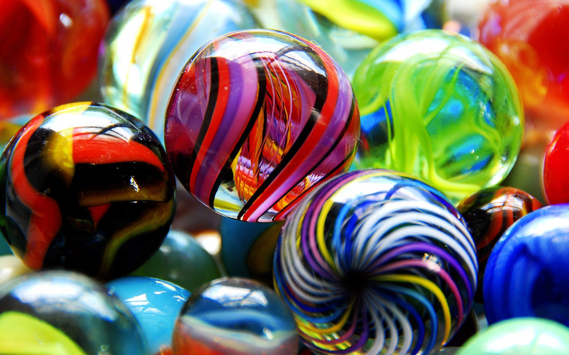 colored glass marbles wallpaper background