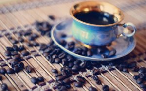 Cup of Coffee with Coffee Beans Wallpaper