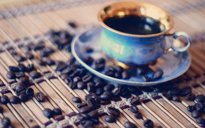 cup of coffee with coffee beans wallpaper background
