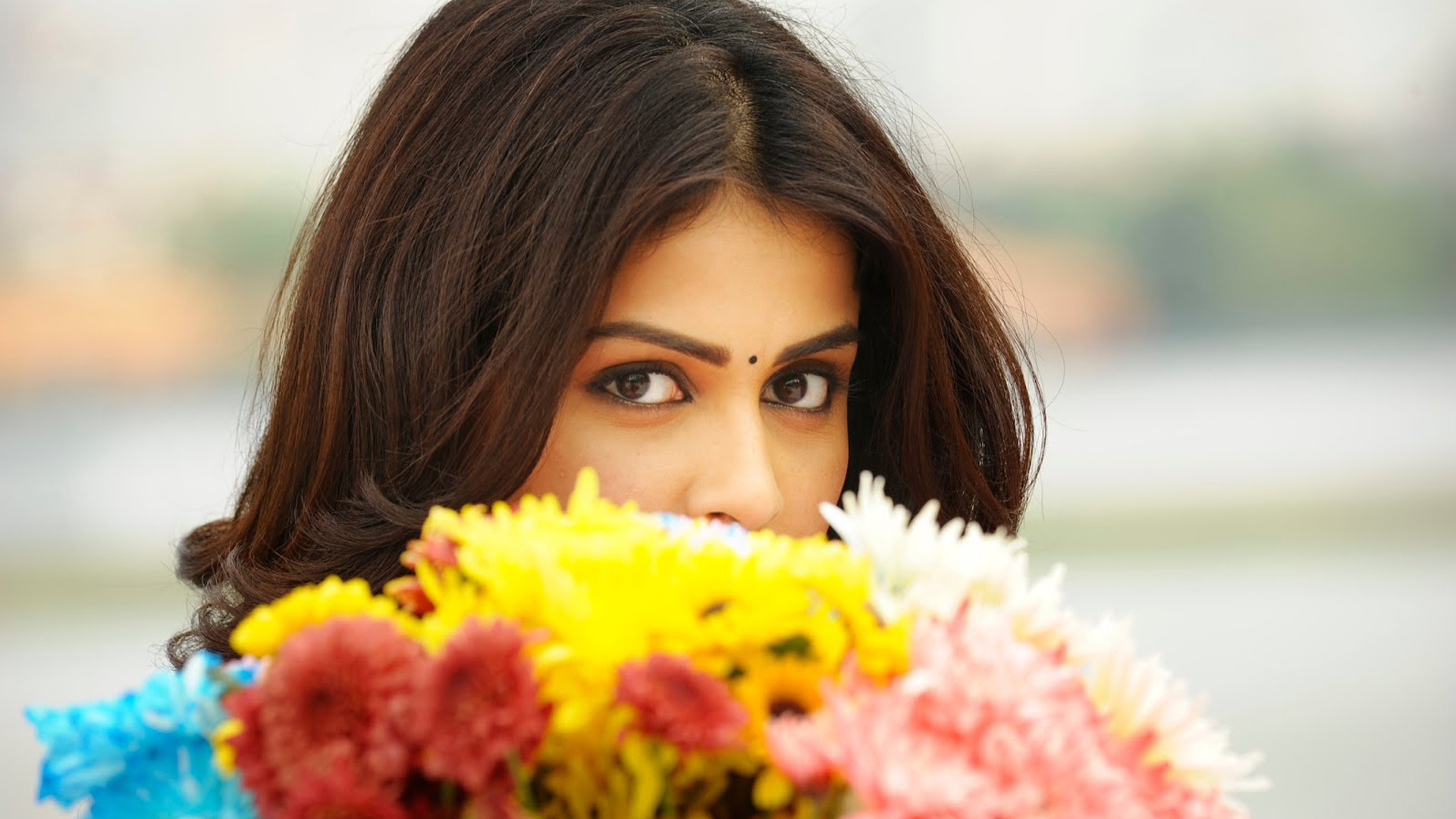 genelia dsouza behind flowers wallpaper background