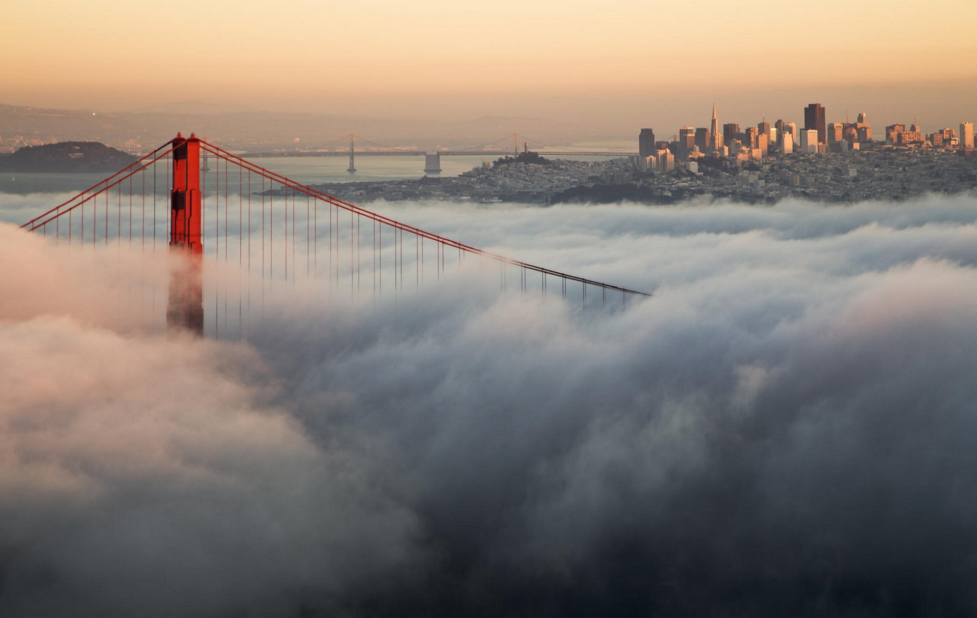golden gate bridge in clouds wallpaper background