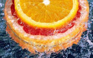 Orange Slices in Water Wallpaper Background