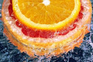 orange slices in water wallpaper background