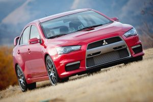 red mitsubishi lancer wallpaper background