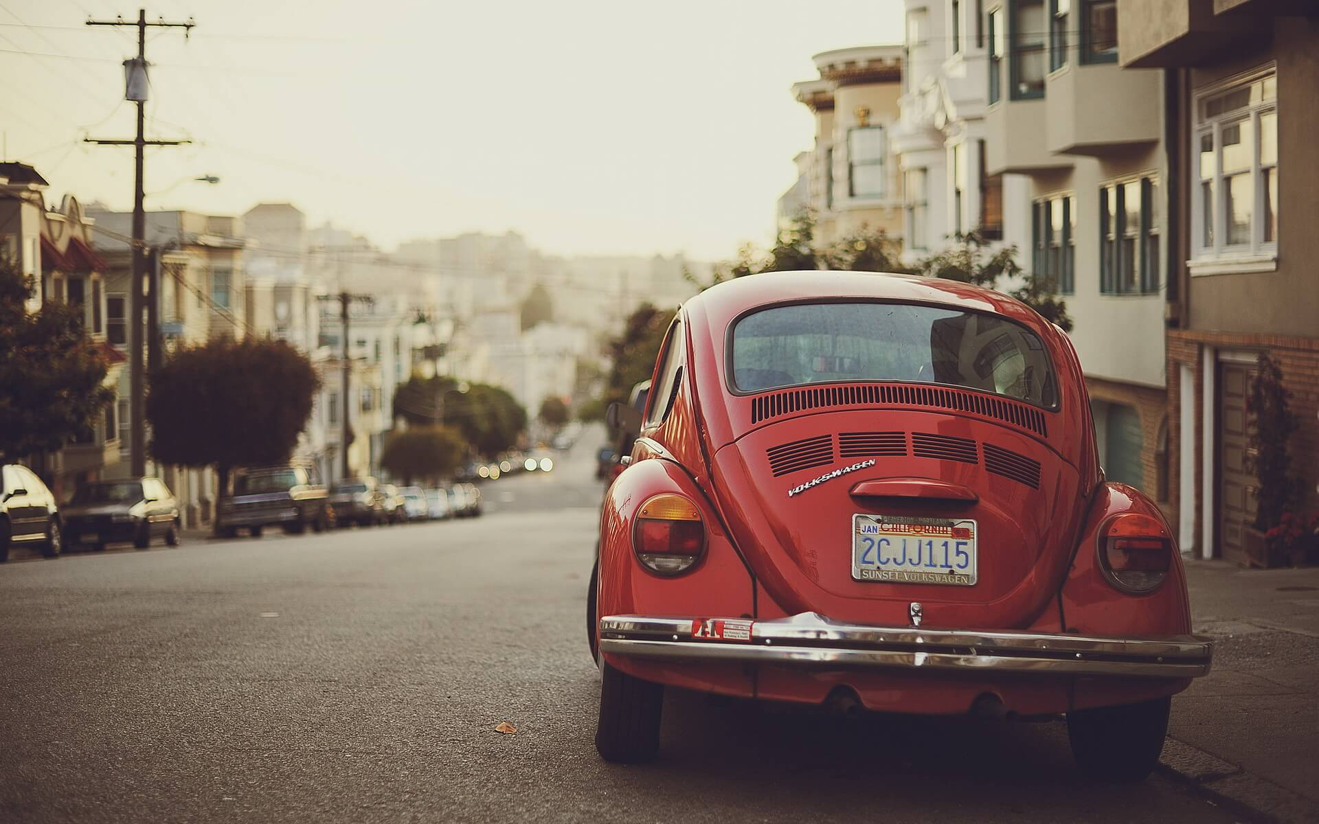 red volkswagen beetle wallpaper background