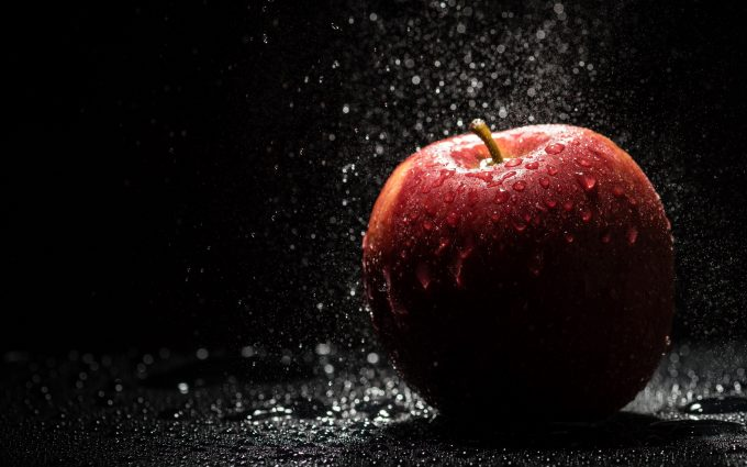 water drops on apple wallpaper 4k background